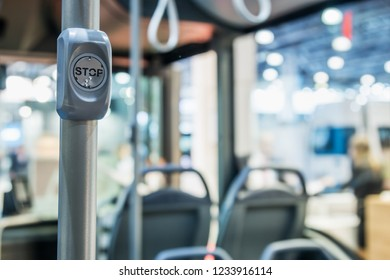 stop button modern and comfortable interior of the city bus. There is a dedicated Braille