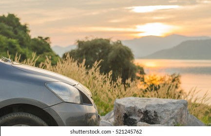 Stop a Car and watching sunset over peaceful river,dam