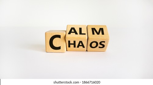 Stop chaos, time to calm. The words 'chaos' and 'calm' on wooden cubes. Beautiful white background, copy space. Business and chaos or calm concept.