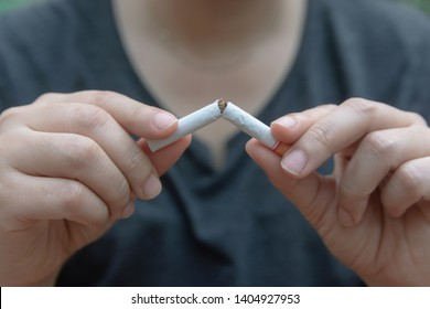 Stop cigarette, woman hands breaking the cigarette with clipping path