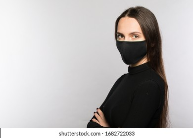 Stop coronavirus infection. The girl in the mask.