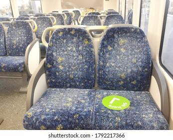 To stop coronavirus, Sydney train service has launch sit here symbol.