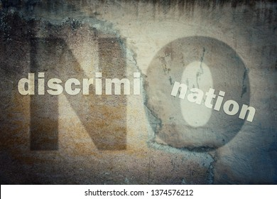 Stop discrimination agains minorities on grounds of race, sex or religion as text written on a cracked concrete wall showing injustice, unfairness metaphor. Human inequality as global social issue.