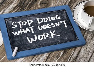 stop doing what does not work handwritten on blackboard