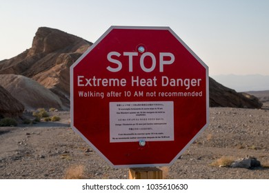 Stop! Extreme heat danger landmark red sign in the hot ridges of Zabriskie Point, Death Valley National Park, hottest place in the world, famous place for adventurous road trip, California USA