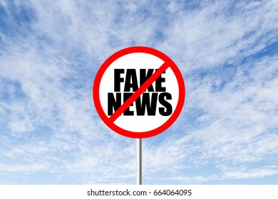 Stop fake news prohibitory traffic sign against blue cloudy sky