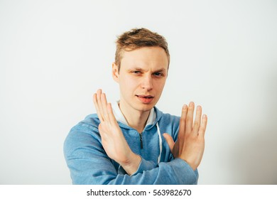 Stop gesture with indignation shown by men