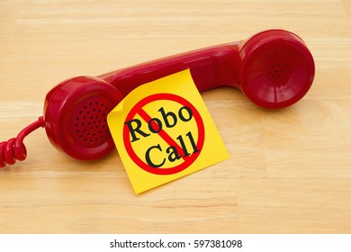 Stop getting a call from a Robocall, Retro red phone handset with a yellow sticky note and text Robocall with not icon