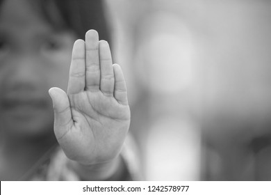 Stop harassment child and stop violence abuse in child. Hand stop no.
