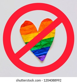 Stop homophobia sign on crumpled paper heart like Gay flag, LGBT symbol. Stopped LGBTQ gay culture concept.