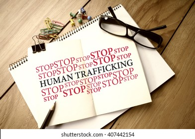 Stop Human Trafficking word cloud on notebook