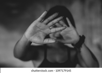 Stop hurting sexual abuse woman, Woman stretching out hand while standing against building.