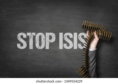 Stop isis text on blackboard with businessman hand holding ammunition