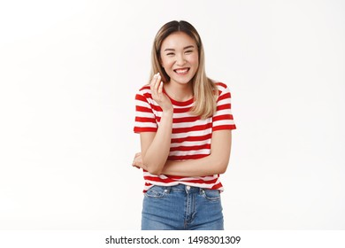 Stop joking belly hurts laughing. Happy emotive charismatic good-looking asian blond girl having fun giggling hilarious comedy gesturing raised hand grinning toothy enjoy friendly outgoing company