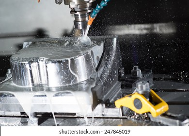 stop motion of CNC machining center milling a part of mould while using coolant.