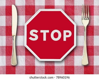 stop on tablecloth with knife and fork