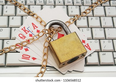 Stop online gambling concept with plaing cards and laptop keyboard