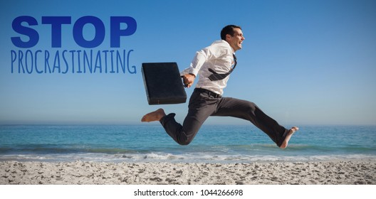 Stop procrastinating against cheerful businessman jumping at beach