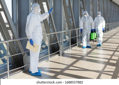 Stop, quarantine. Men in coronavirus hazmats prevention coronavirus pandemic outdoor, copy space