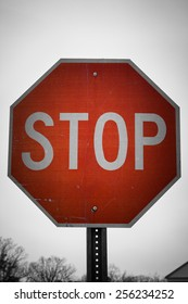 A stop road sign or symbol in vintage style