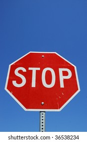 stop sign against blue sky room for your copy
