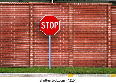 Stop sign against a brick wall. This would be the last stop sign you run.