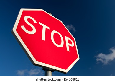 Stop sign against deep blue sky. Close up.