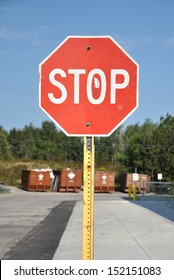 Stop sign along sidewalk