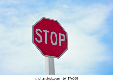 Stop sign with the blue sky background.