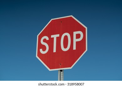 Stop Sign with a Blue Sky Background.