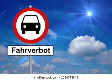 stop sign with car and the german word driving ban and a blue sky