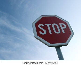 Stop sign in the evening