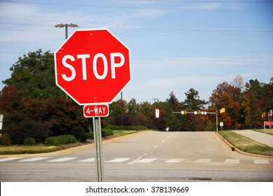 stop sign in front of road crossing