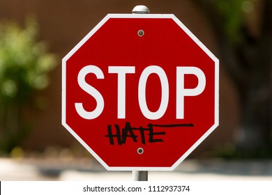 stop sign with graffiti