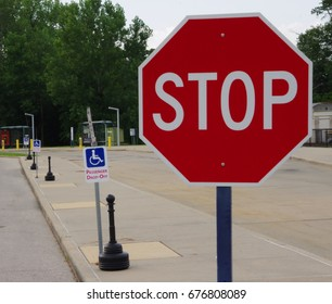 Stop Sign with Handicap Sign in background