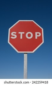 Stop sign isolated over blue sky