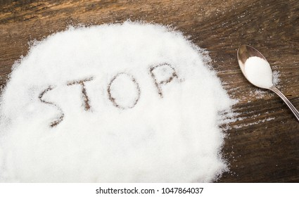 Stop sign made of granular sugar. The picture illustrates the harm of eating sugar and salt, as well as dependence on flavoring additives.