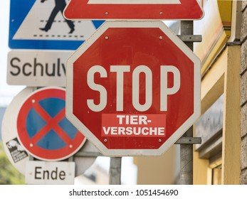 """STOP sign with a manually added sticker reading """"TIERVERSUCHE"""" = animal testing: Thus the traffic sign is highjacked to convey the demand to stop animal testing."""