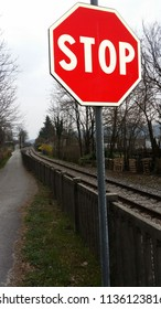 stop sign nearby the railway