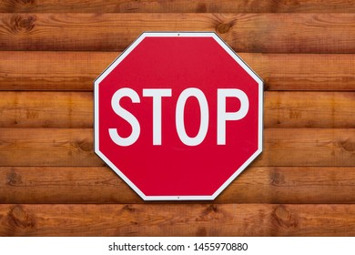 stop sign on the background of wooden boards, close up