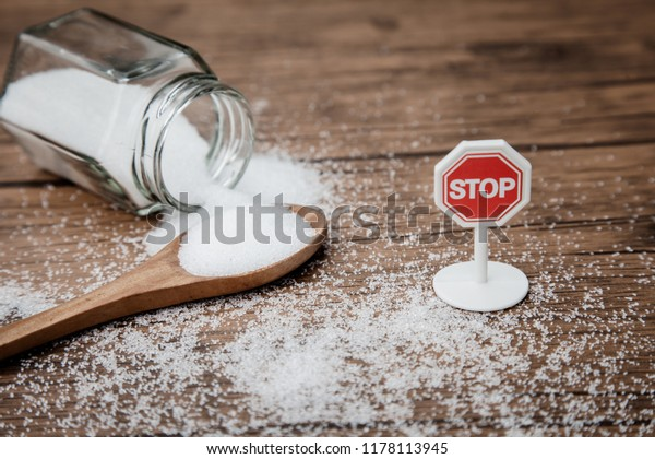 Stop sign on the sugar, warned that the sugar too much will make unhealthy nutrition, obesity, diabetes, dental care and much more.