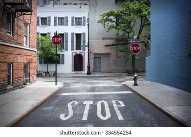 Stop Sign painted on the road at Minetta Street And Minetta Lane Corner in New York City