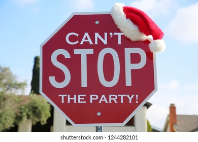 Stop Sign. Red Stop Sign with Santa Hat. Sign Reads, Can't Stop The PARTY. Room for text. Text is easily removed and replaced with your own.