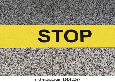 Stop sign yellow line at marble floor warning