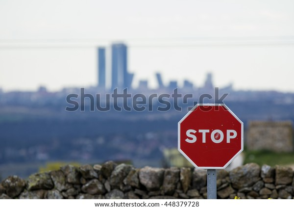 Stop signal with city behind
