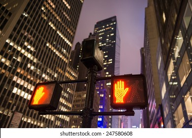 Stop signs in Manhattan at night