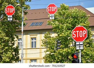 Stop signs at the road crossing