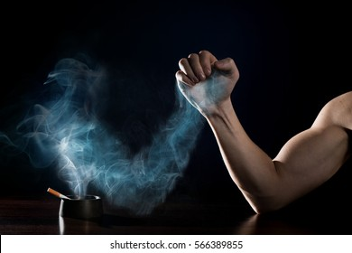stop smoking concept. Human hand is struggling with a hand of smoke. Quit smoking now