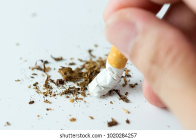 Stop smoking with human hands breaking the cigarette or hand crushing cigarette quitting smoking concept