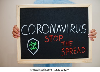 Stop the spread. Coronavirus concept. Boy hold inscription on the board.